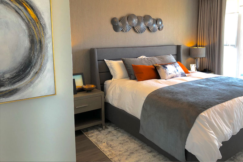 Condo bedroom designed with greys and white