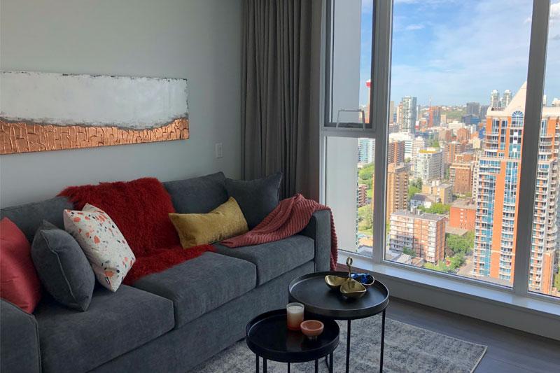 Condominium Den with art and view of Calgary