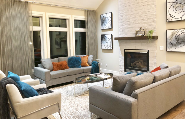 grey burnt orange living room design with fireplace